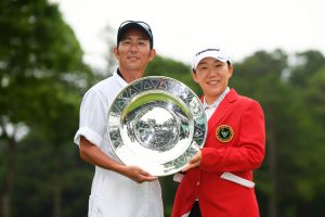 SODEGAURA, JAPAN - JUNE 30: Jiyai Shin of South Korea poses with her caddie after the award ceremony following the final round of the Earth Mondamin Cup at the Camellia Hills Country Club on June 30, 2019 in Sodegaura, Chiba, Japan. (Photo by Atsushi Tomura/Getty Images)